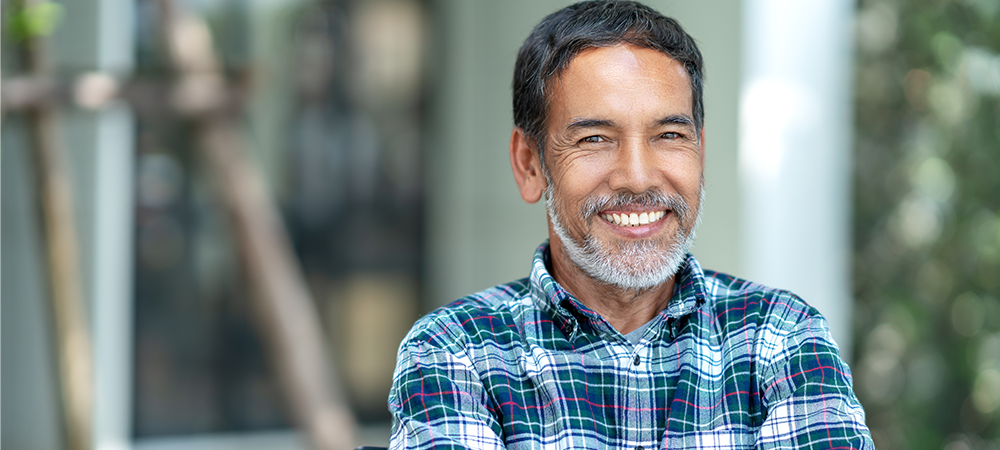 Smiling middle aged Indian man