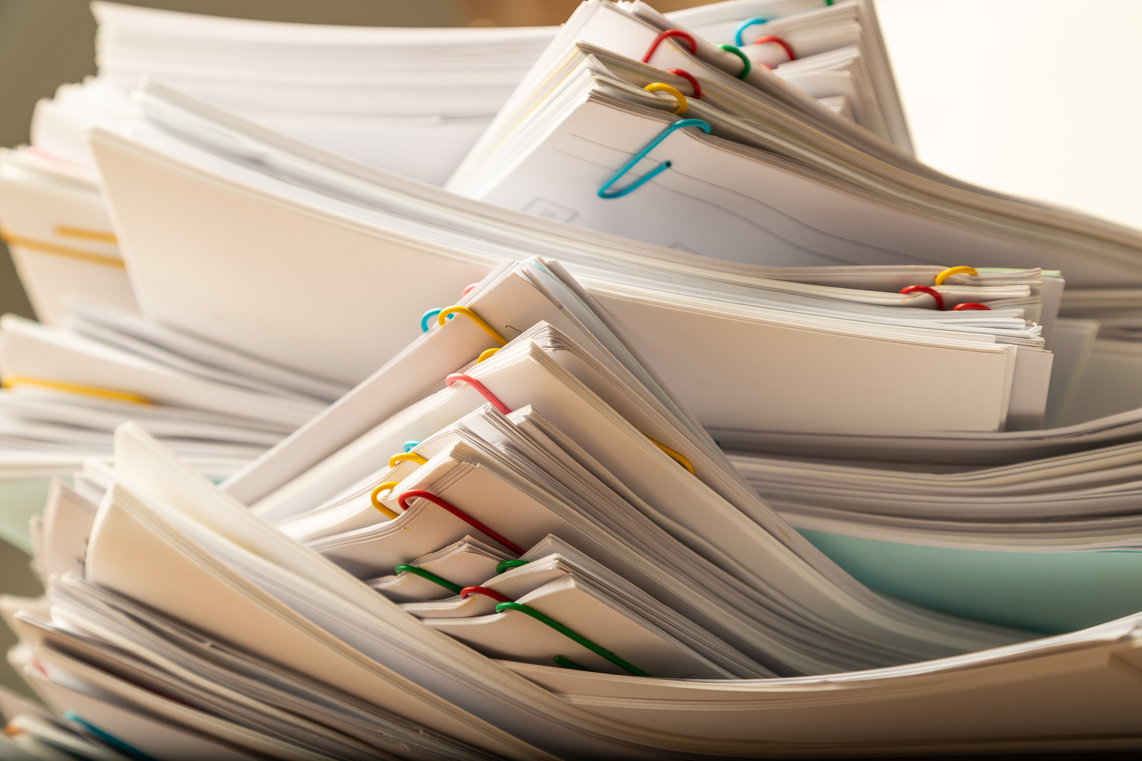 Stacks of papers - call Liberty Paperwork Solutions